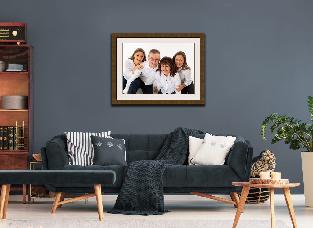 framed family portrait display in living room