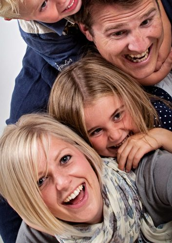 pile on family portrait at session with Sarah Offley